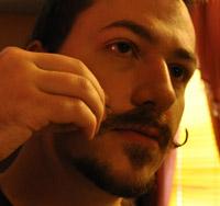J. M. DeSantis curling handlebar moustache
