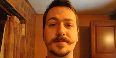 J. M. DeSantis handlebar moustache messy